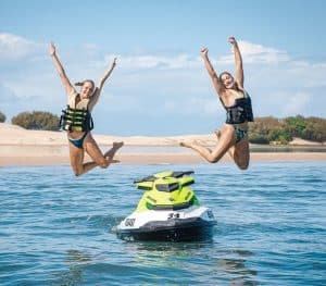 Girls Jumping Off Jet Ski in Main Beach