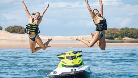 Girls Jumping Off Jet Ski in Main Beach